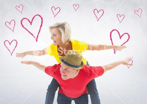 Mature woman giving piggy back to woman