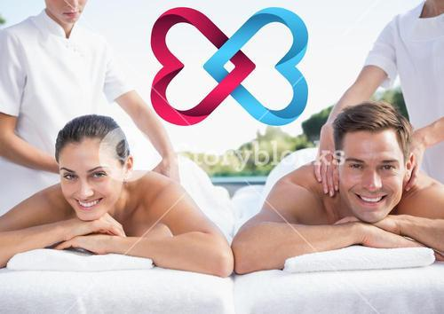 Couple in spa and and digitally generated interlocked hearts