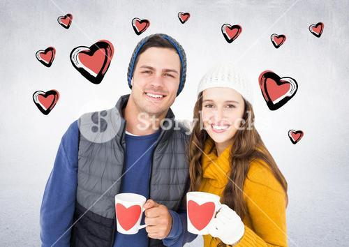 Couple with coffee mugs against white background with hearts