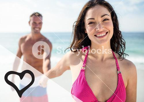 Happy couple holding hand at the beach