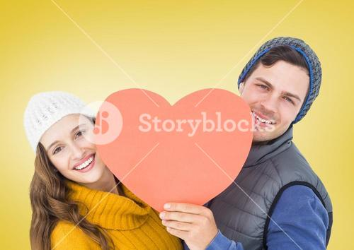 Happy couple holding heart