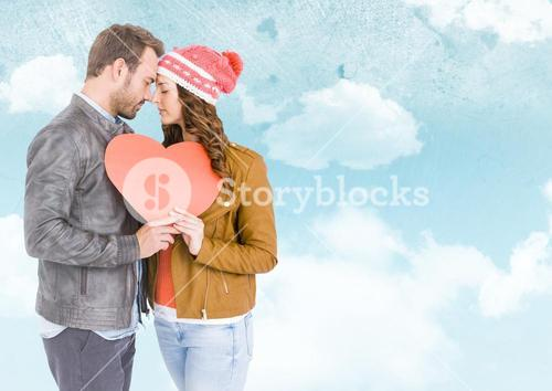 Romantic couple holding heart