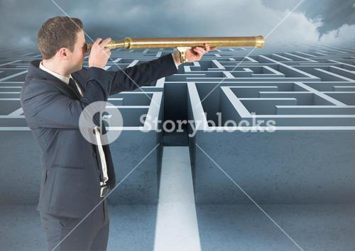 Business man with telescope looking over maze