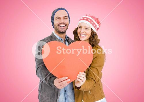 Smiling couple holding heart