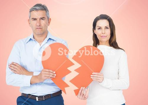 Upset couple holding broken heart