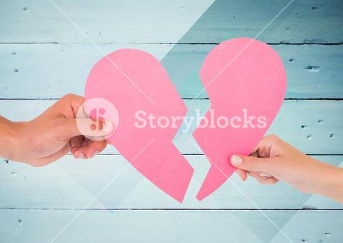 Hands of couple holding broken heart