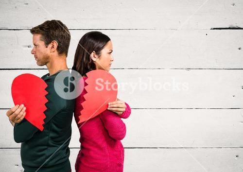 Angry couple holding broken heart