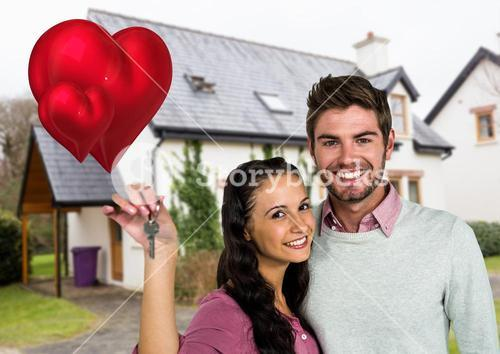 Portrait of couple showing new home key