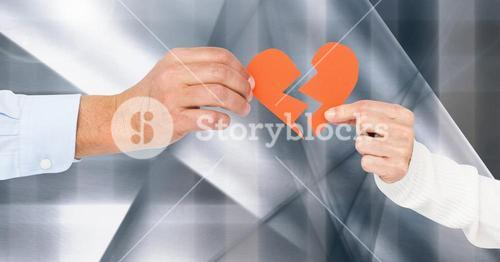 Hand of couple holding red heart