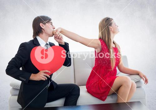 Man with red heart pleasing upset woman