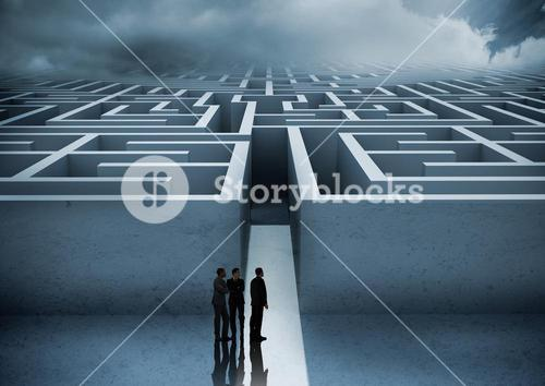 Business people looking at maze