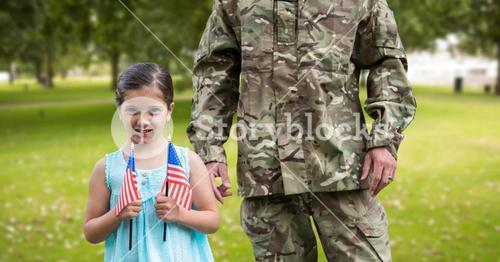 Portrait of girl holding american flag