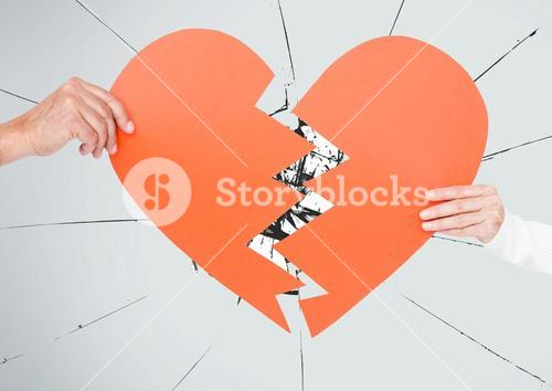 Hand of couple holding broken hearts