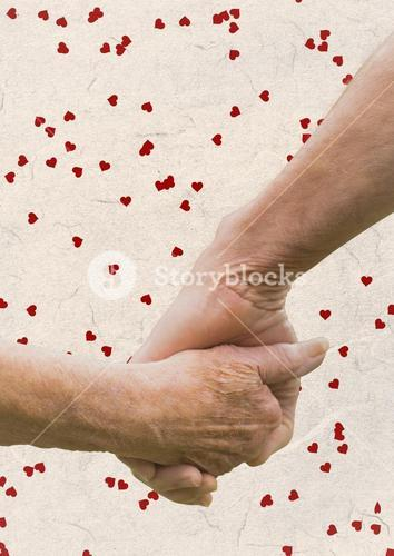 Hand of senior couple holding hands