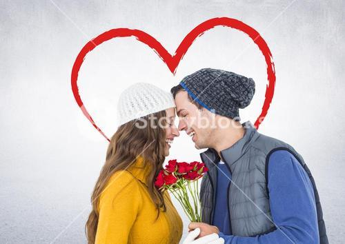 Romantic couple with face to face holding roses