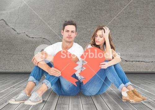 Sad couple sitting together with broken hearts