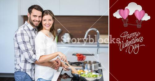 Portrait of smiling couple embracing while cooking food