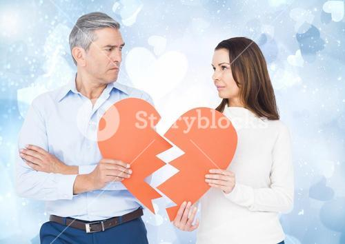 Mature couple holding a broken heart