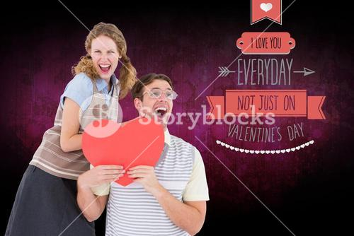 Excited couple holding heart