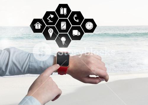 Hands using smartwatch with digitally generated icons