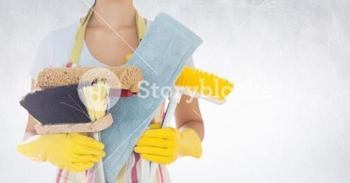 Mid section of woman holding various cleaning equipments