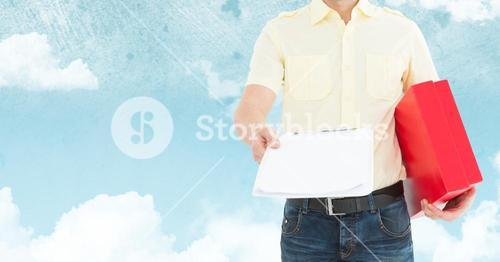 Mid section of delivery man holding clipboard and parcel box