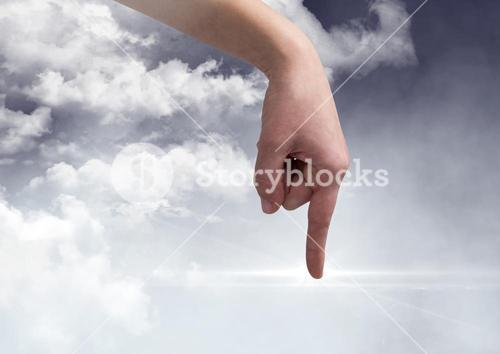 Hand pointing against digitally generated Clouds