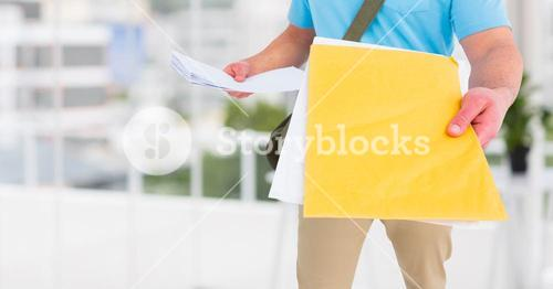 Delivery man holding couriers