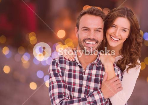Portrait of couple embracing each other against digitally generated background