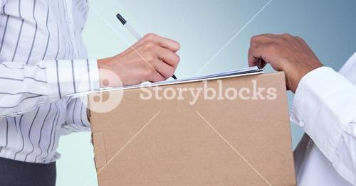 Businesswoman accepting a delivery of box from deliveryman