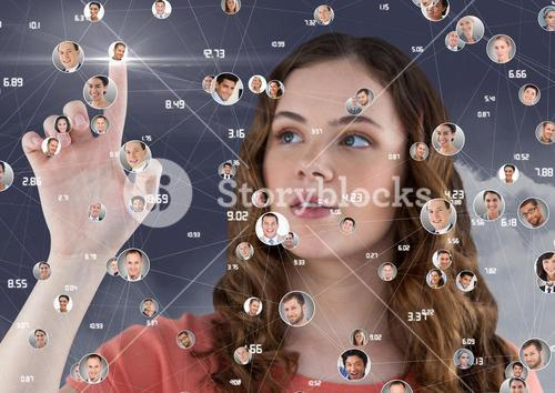 Woman touching digitally generated social networking icons