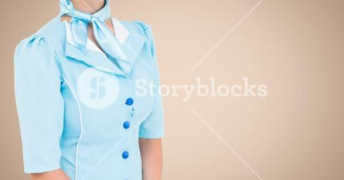 Air hostess standing against beige background