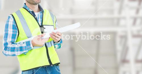 Construction man standing with blue print