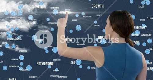 Woman touching digitally generated application icon