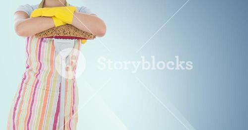 Female cleaner standing with mop against blue background