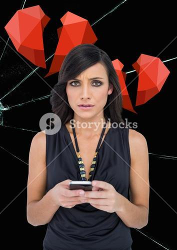 Upset woman texting against broken hearts and cracked hearts