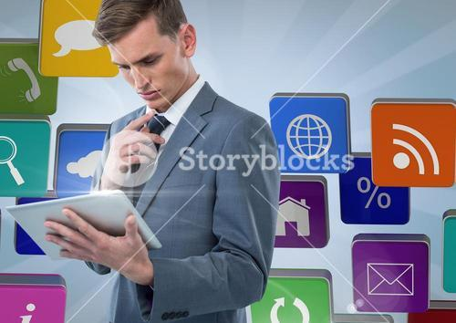 Businessman using tablet against applications icons