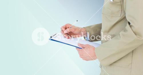 Mid section of delivery man writing on clip board