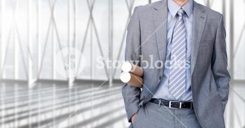 Mid-section of businesswoman with rolled charts