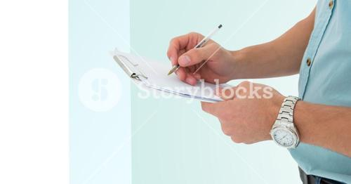 Mid section of man writing on a clipboard