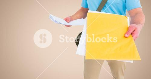 Mid section of delivery man with documents