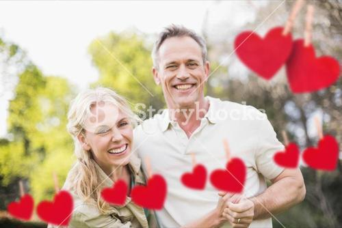Composite image of romantic couple enjoying together