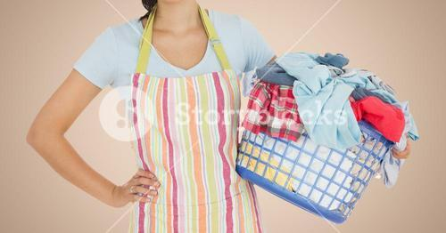 Mid section of woman holding basket full of clothes