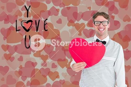 Portrait of happy man holding heart shape