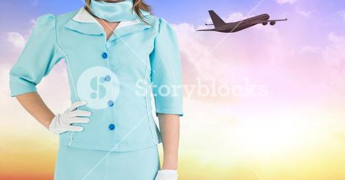 Mid section of air hostess with hands on hip