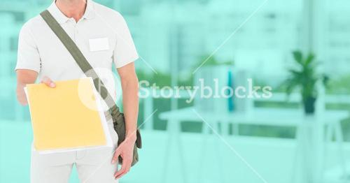 Delivery man with documents in office