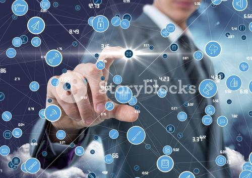 Businessman touching digitally generated connecting icons