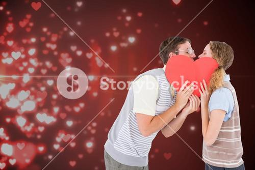 Couple holding heart and kissing