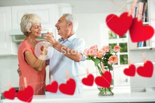 Senior couple dancing at home