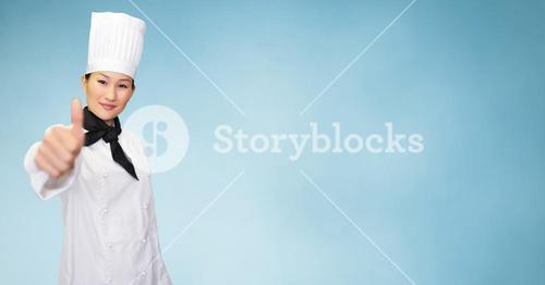 Smiling female chef giving thumbs up sign